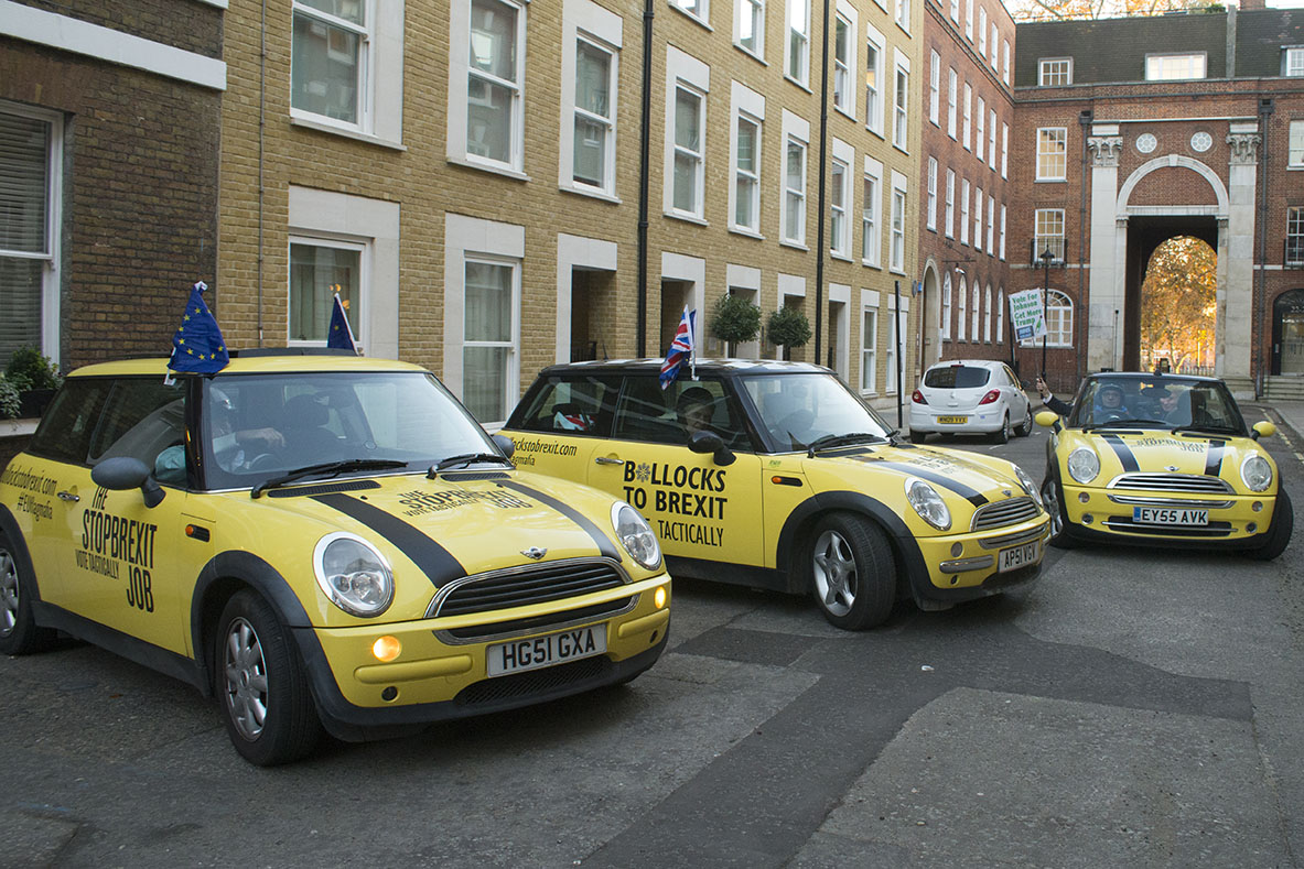 3 Dec 2019 - London, UK - Minis in Essex Street, London in a stunt organised and crowdfunded by anti-brexit campaigning group EU Flag Mafia.