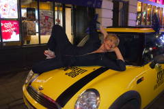 3 Dec 2019 - London, UK - Woman lying on bonnet of mini at Old Compton Street in a stunt organised and crowdfunded by anti-brexit campaigning group EU Flag Mafia.