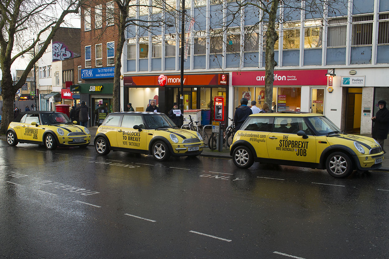 Swindon, UK - 06 Dec 2019 - EU Flag Mafia minis visit Swindon to protest against Brexit and call for a tactical vote. EU Flag Mafia are an anti-brexit protest group.