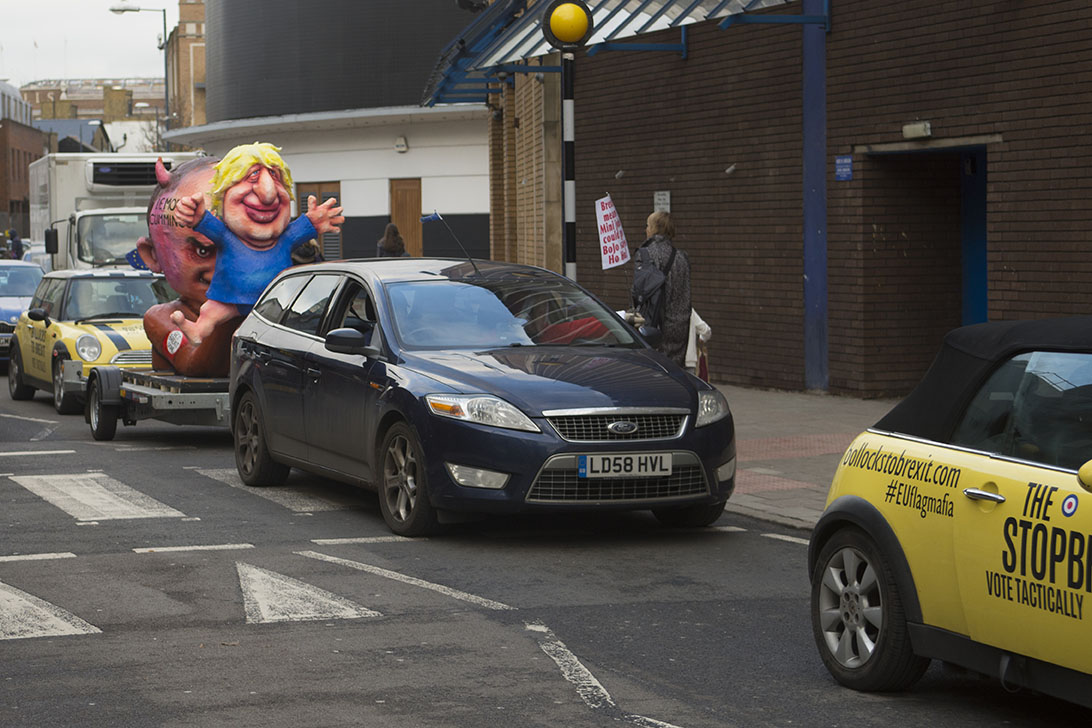 Kingston-on-Thames, UK - 07 Dec 2019 - Anti Brexit protest group EU Flag Mafia bought 3 minis and, along with a Jacques Tilley float depicting Boris Johnson and Dominic Cummings toured Esher, Kingston, Uxbridge and Ickenham,