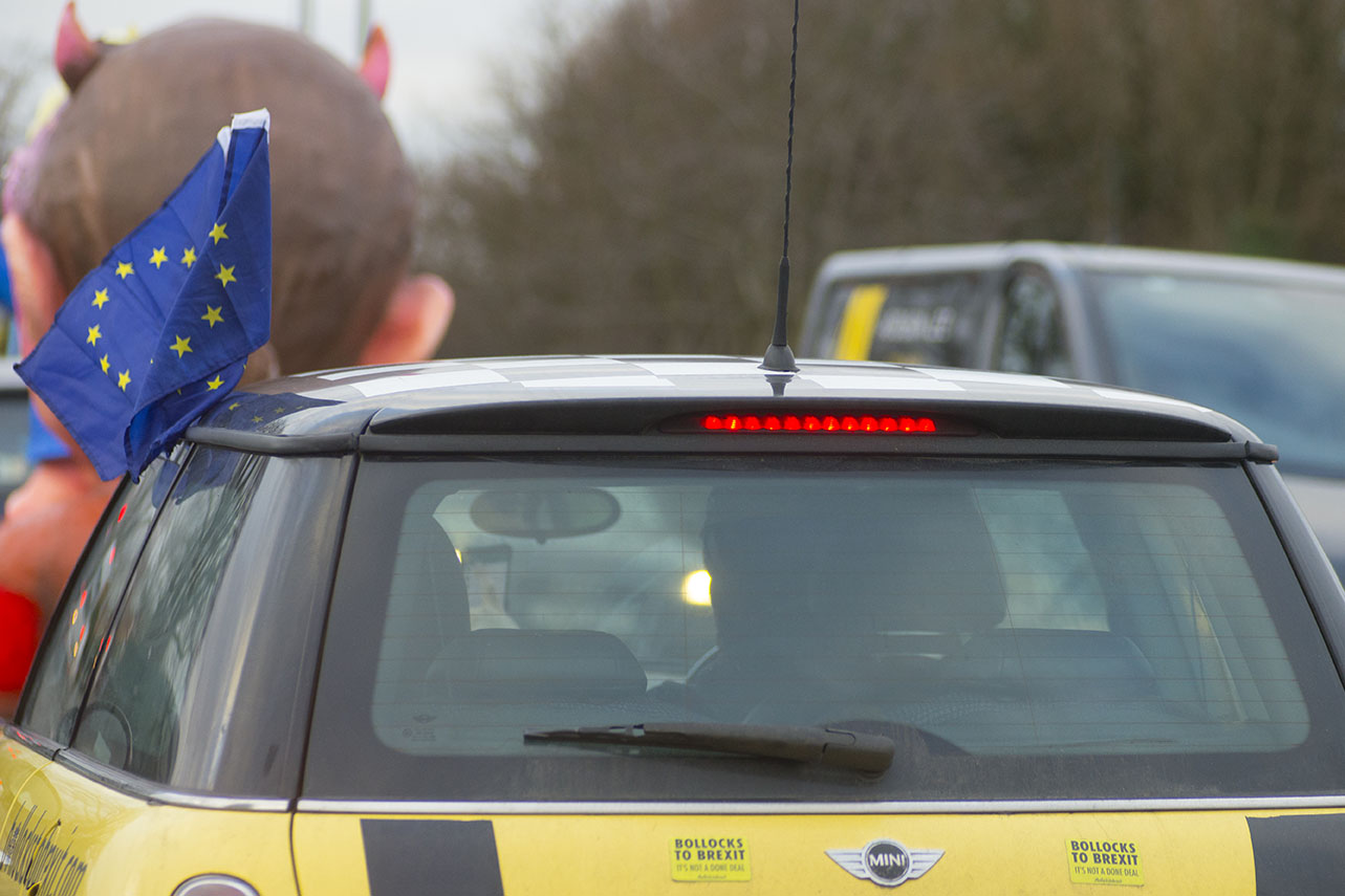 West London, UK - 07 Dec 2019 - Anti Brexit protest group EU Flag Mafia bought 3 minis and, along with a Jacques Tilley float depicting Boris Johnson and Dominic Cummings toured Esher, Kingston, Uxbridge and Ickenham,